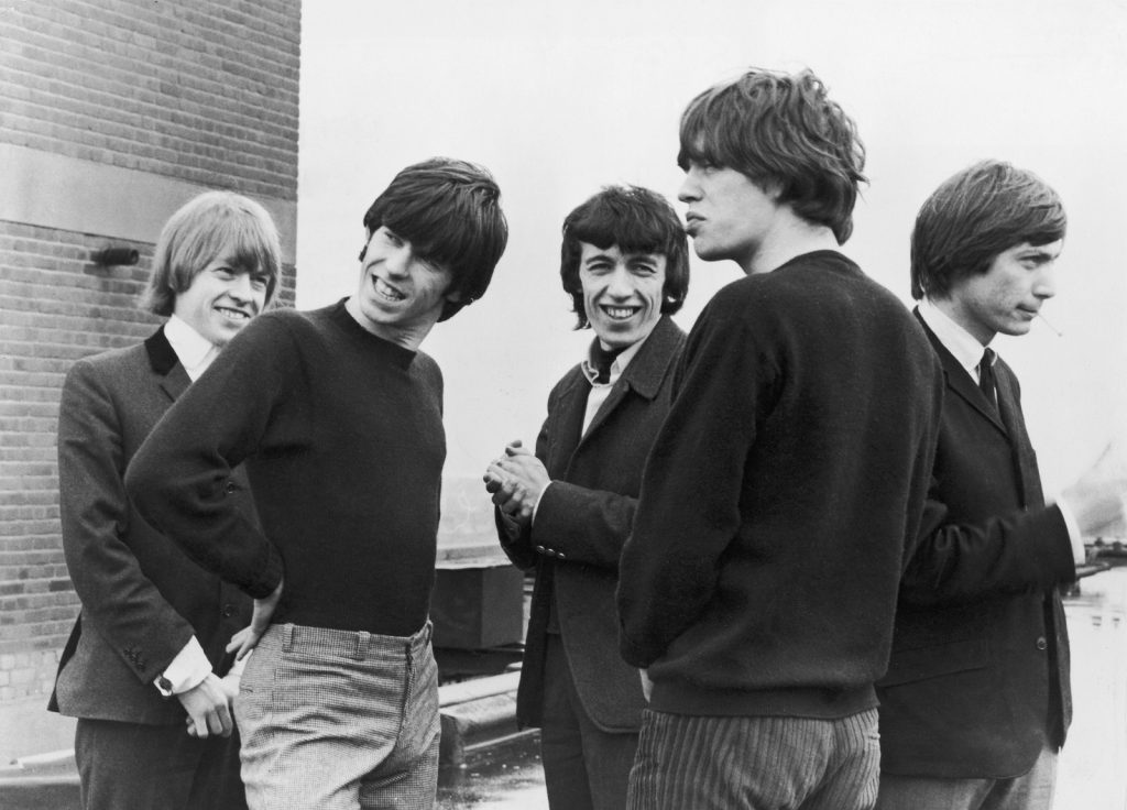The Rolling Stones on a rooftop, 17th June 1964. Left to right: Brian Jones (1942 - 1969), Keith Richards, Bill Wyman, Mick Jagger and Charlie Watts. (Photo by Archive Photos/Getty Images)